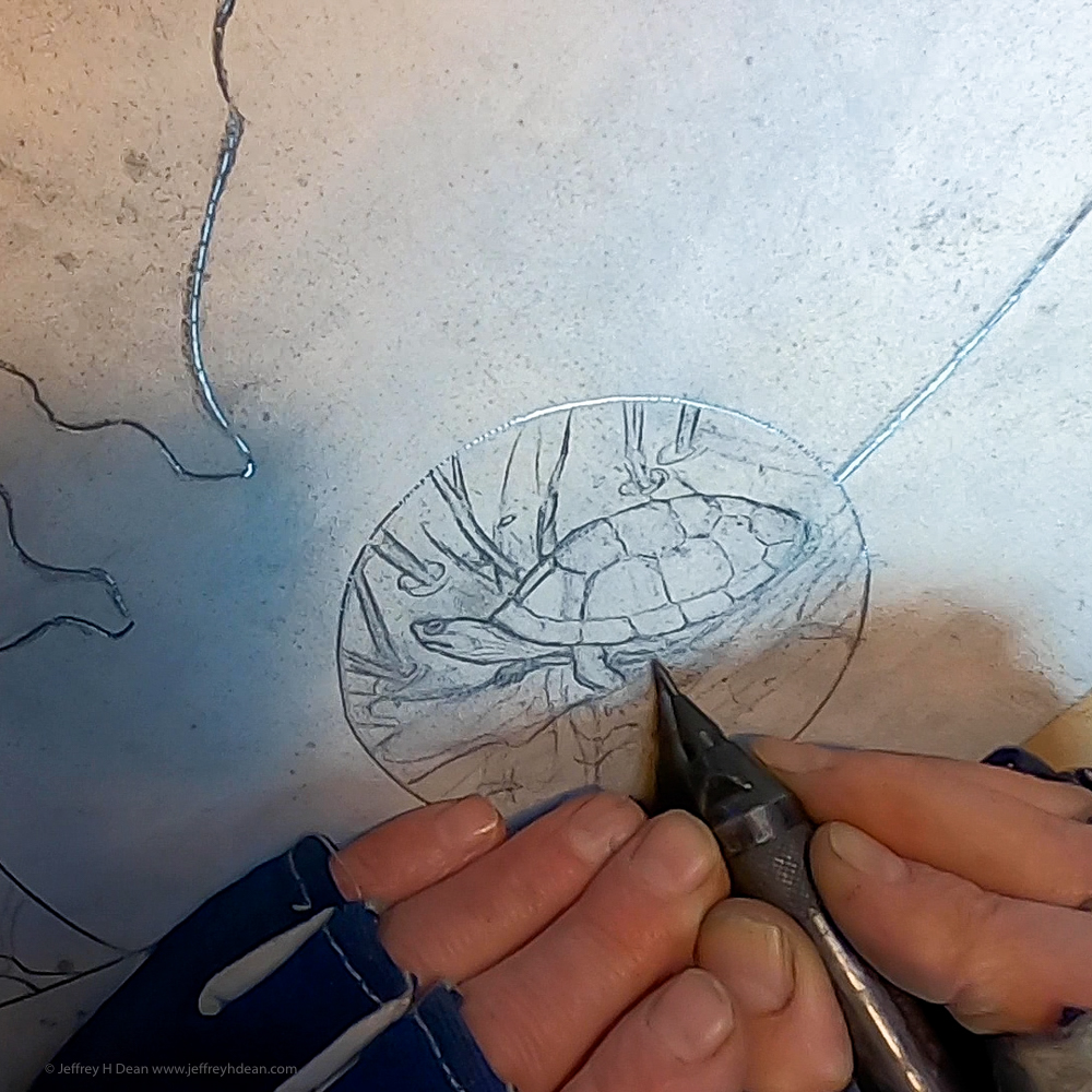 Engraving a painted turtle with a Suhner engraver.