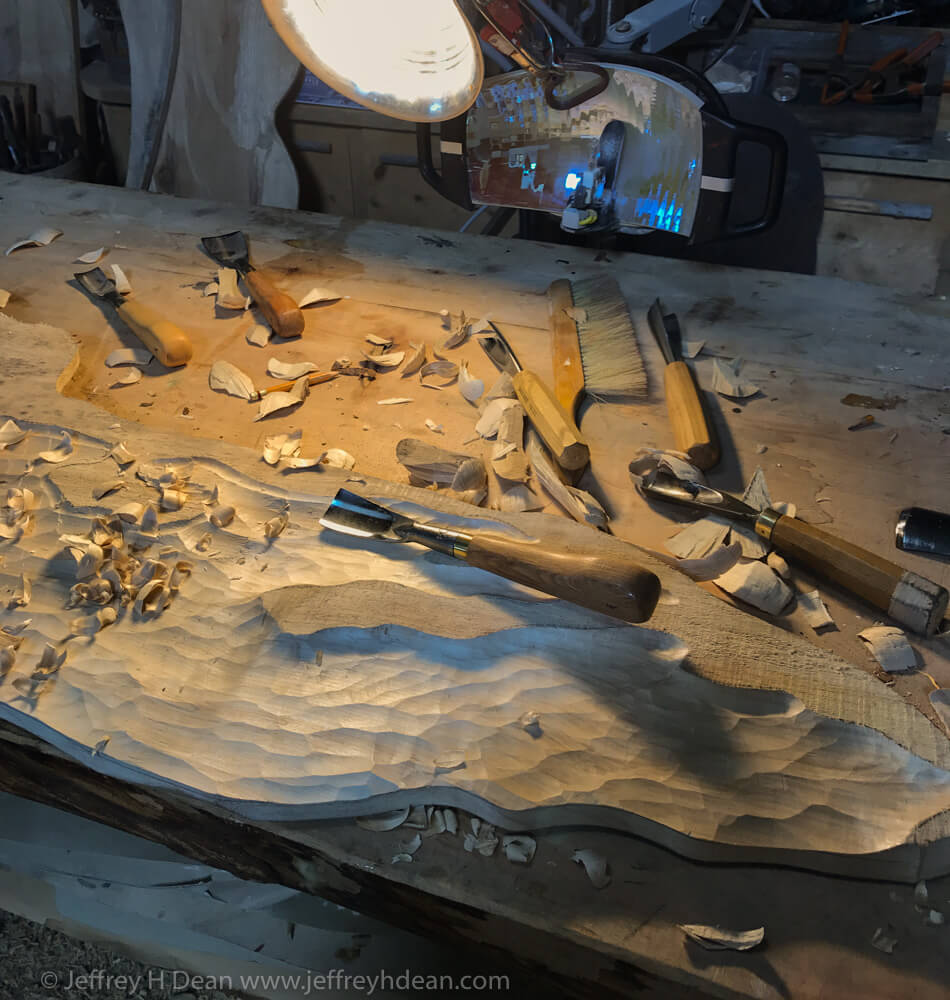 Carving the Ice flow out of cottonwood lumber with woodcarving gouges.