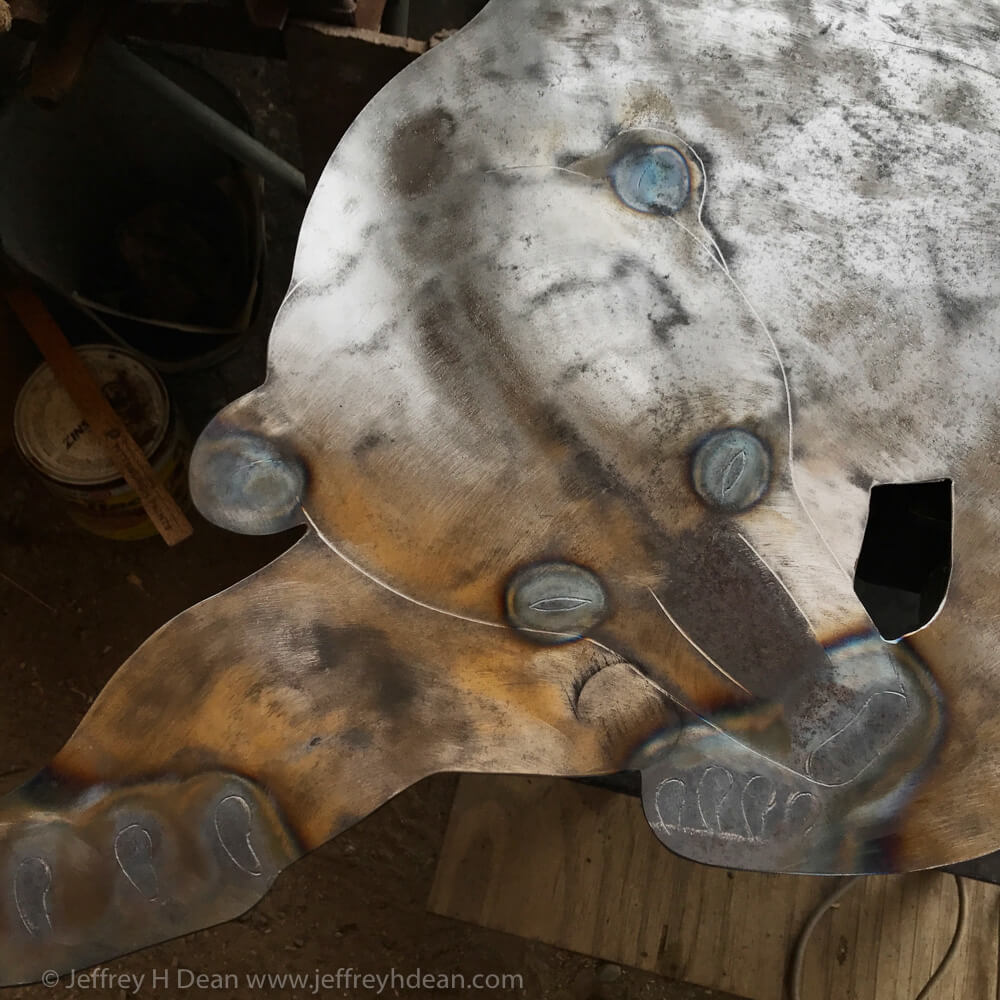 The sunglasses stage. An oxy acetylene torch is used to locally color the darker features on the polar bear.
