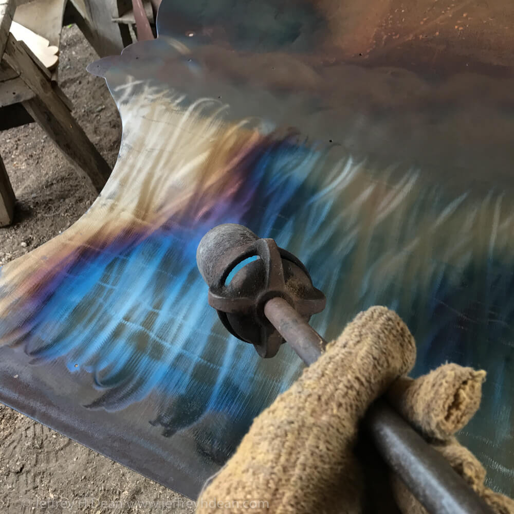 This example of heat coloring steel shows the process of coloring the ocean layer of piece of multi-layer metal wall art with the heat from a large propane torch. For larger piecs of thinner steel, I do the coloring from one side to the other rather than with a uniform even heat on the whole piece.