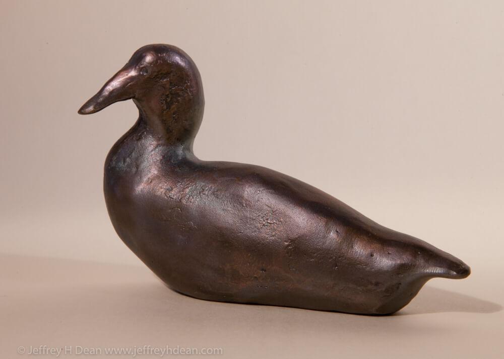 Small bronze duck sculpture