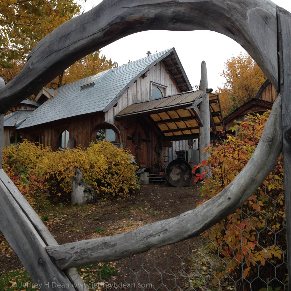 Looking through the gate up to the Creative Fires Studio workshop.