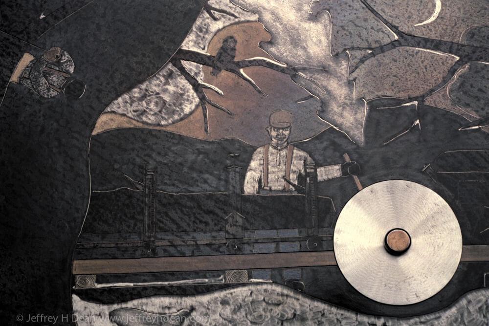 G & G Lumber sawmill scene. Engraved steel sawblade with heat tints.