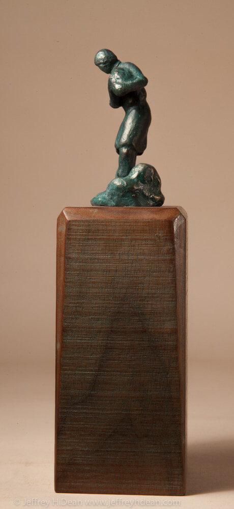 Bronze miniature sculpture of man carrying a basket of mountain herbs.