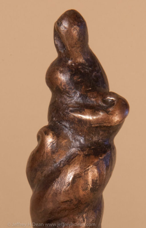 Bronze miniature sculpture of a figure in the form of gathering storm clouds.