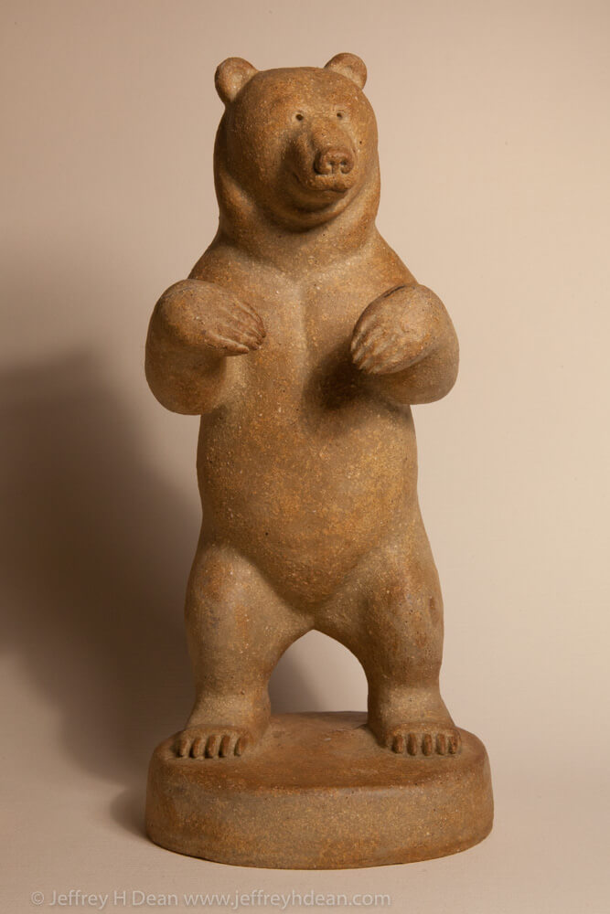 Clay grizzly bear sculpture. Available in bronze.