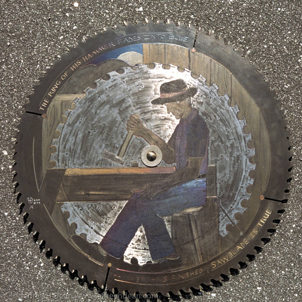 """""""The ring of his hammer fades into blue,  hammer man's finished,  sawblade is true.""""  Engraved steel  saw blade metal wall art with heat tints."""