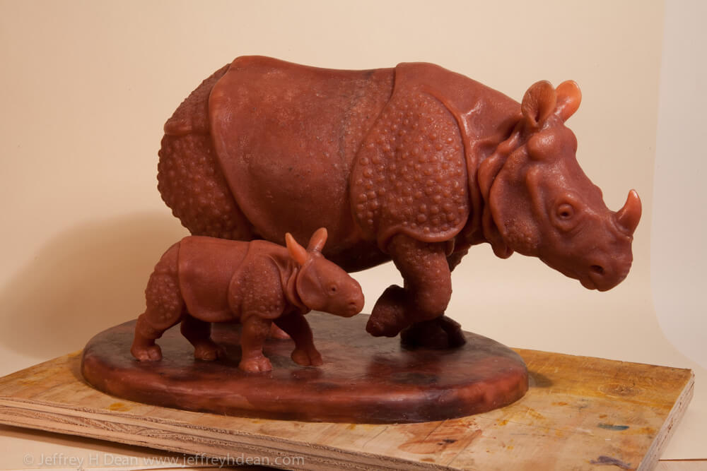 Mother and baby Indian rhinoceros. Wax model for bronze.