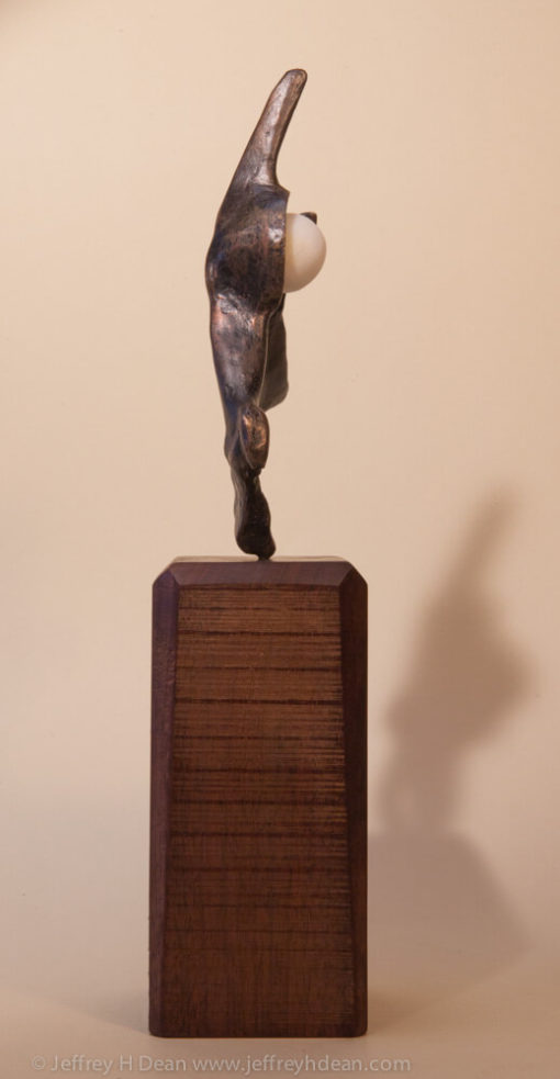 Bronze figure with alabaster moon, modeled after a fragment of mammoth pelvic bone.