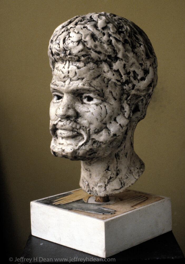 Plaster portait sculpture of man from Africa.