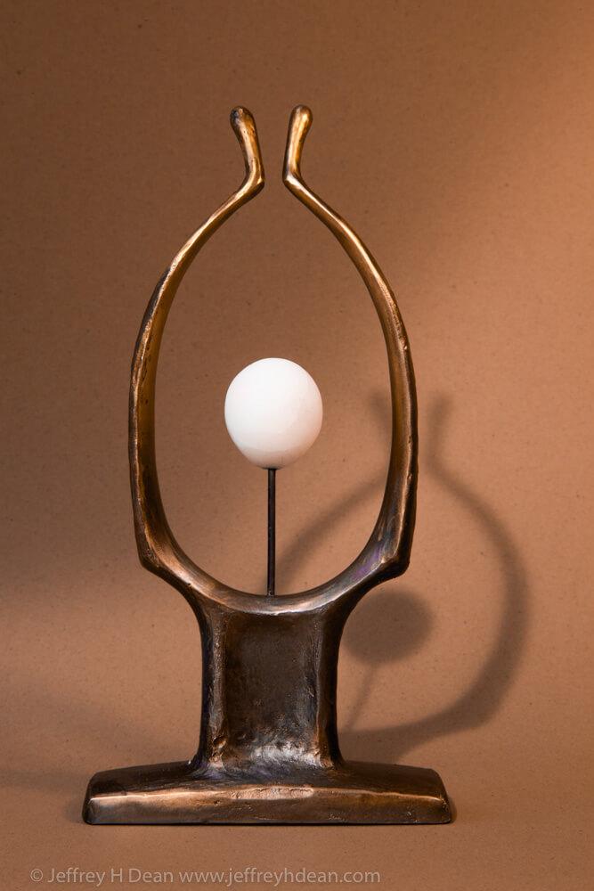 Abstract bronze figure. Renaissance, rebirth, new beginnings, inspiration.
