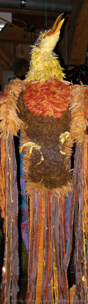 Rising phoenix puppet made from wood, steel strapping and woolen yarn with Grancrete egg.