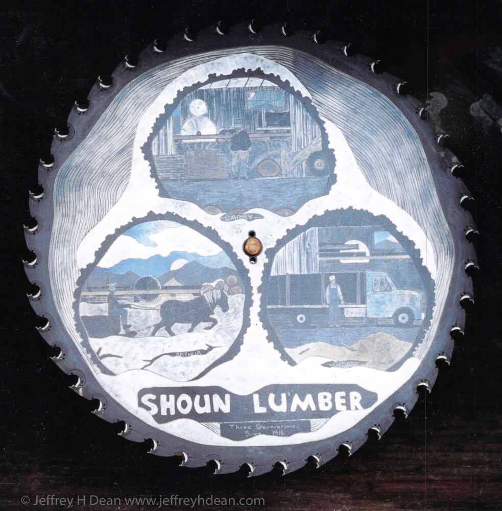 Engraved steel saw blade metal wall art with heat tints, depicting three generations at Shoun Lumber in Butler, TN.