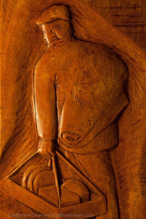 Relief of Sicilian street vendor.
