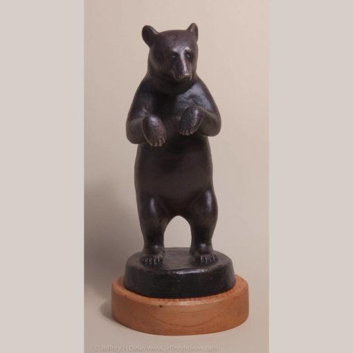 Bronze sculpture of standing black bear