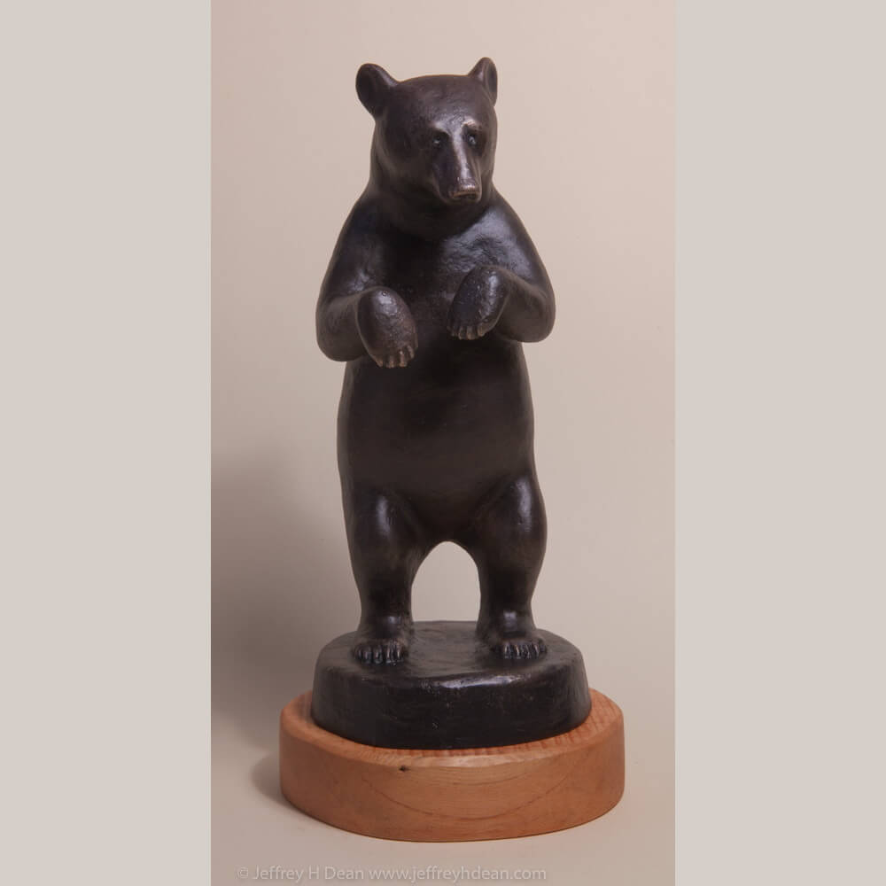 Bronze sculpture of standing black bear