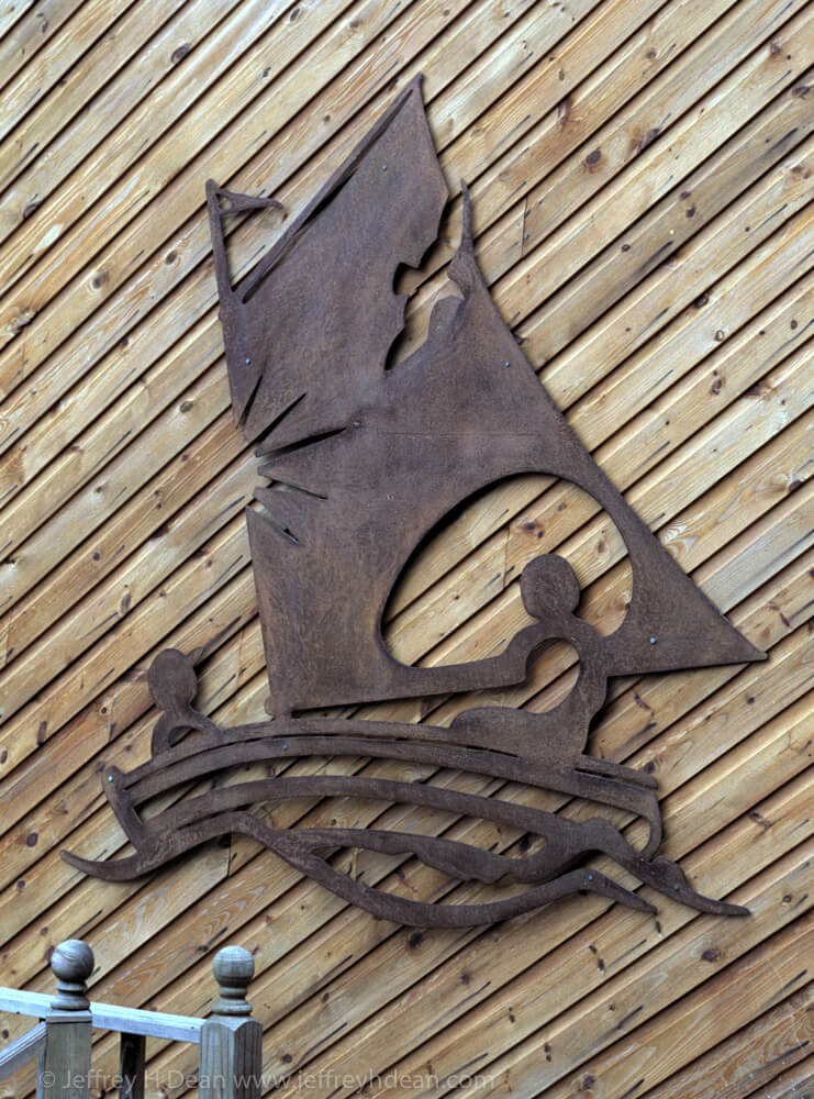 Sailing in the summer sun with a seagull and fish. Pierced steel wall sillohette.