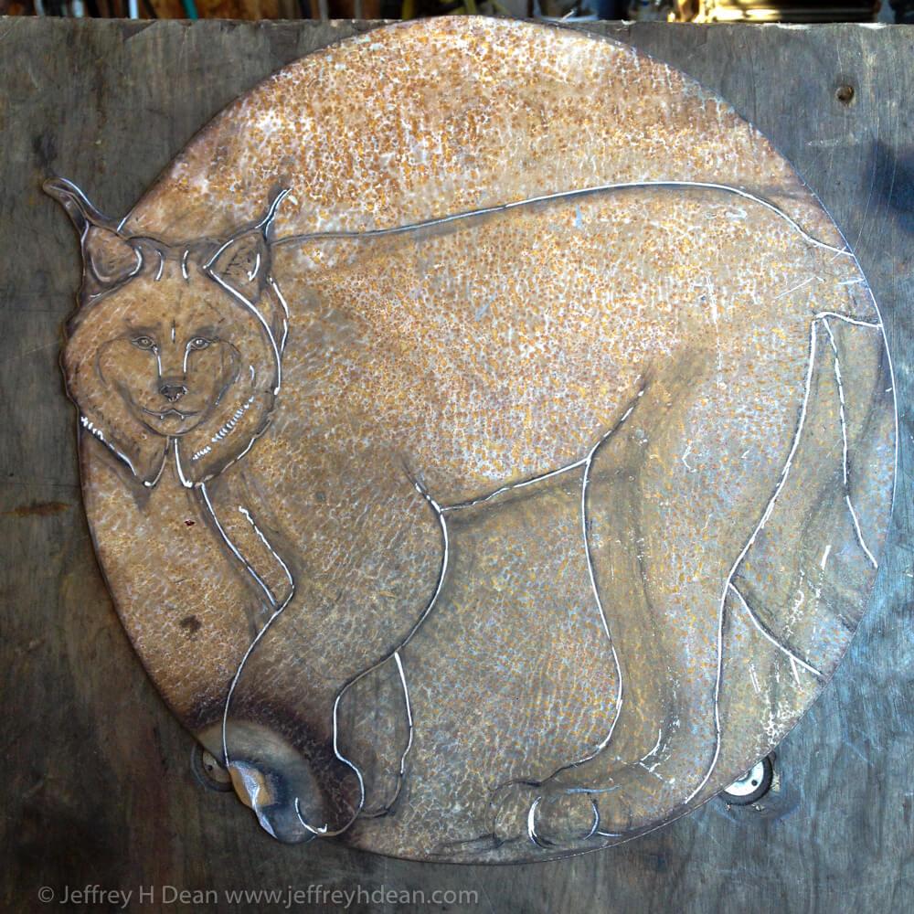 Process photo for engraved steel relief for Denali State Park Kesugi Ken Interpretive Center.