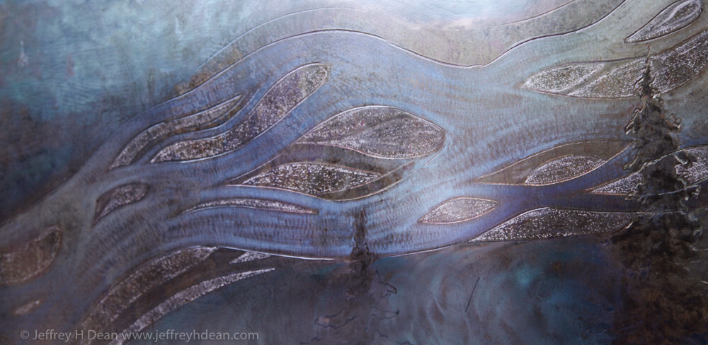Braided Culitna River in heat tinted engraved steel.