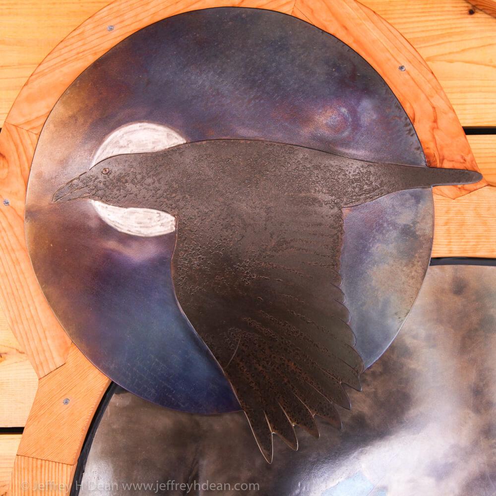 Raven flys across the sun.