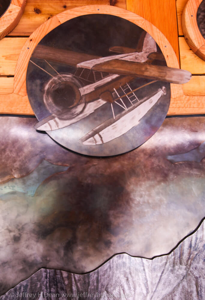 Norseman float plane in engraved steel. Part of Through Your Spotting Scope wall art at Denali State Park.